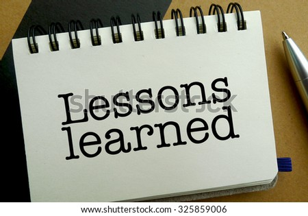Lesson learned memo written on a notebook with pen