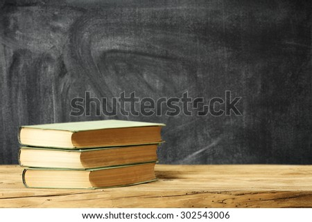 lesson time books chalkboard and desk space  - stock photo