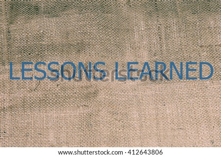 lessons learned text on brown burlap. burlap, canvas texture retro background