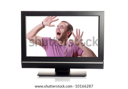 Let me out - Person struggling to escape from inside a TV - stock photo