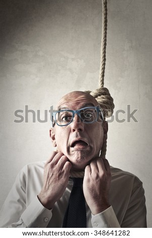 Let's put his head in the noose - stock photo