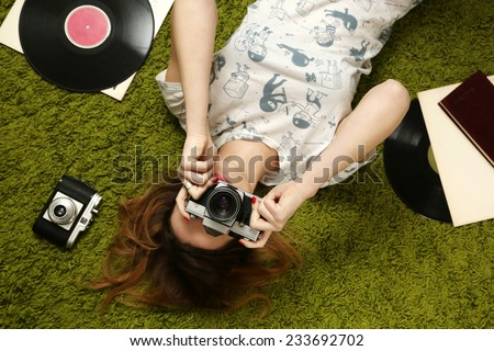 Let's take some photos!, Young woman taking picture with an old vintage camera - stock photo