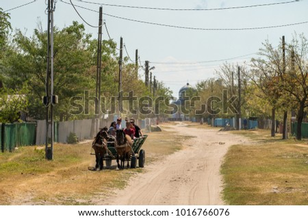 Letea, Danube Delta, Romania, August 2017: Peasants traveling with a cariage in the Letea traditional fishing village in Delta Dunarii, Romania1