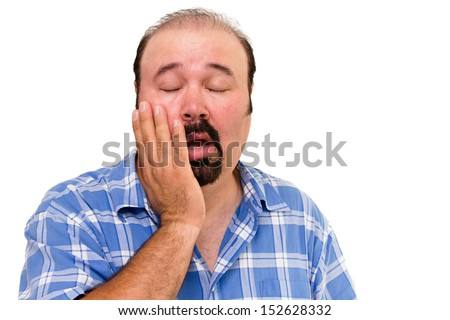 Lethargic lazy man with his hand raised to his cheek and eyes closed and a bored disinterested expression isolated on white - stock photo