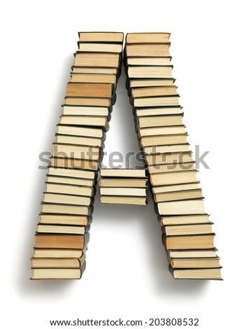 Letter A formed from the page ends of closed vintage hardcover books standing on a white background from a set or series of numbers