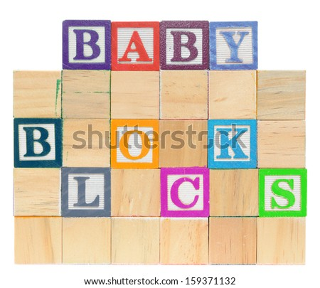 Letter blocks spelling baby blocks. Isolated on a white background. - stock photo