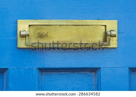 Letter box and door knocker conceptual closeup
