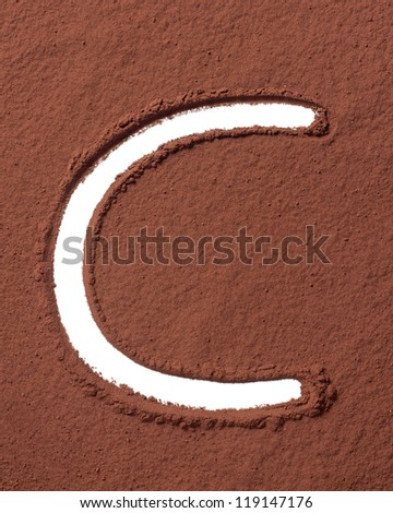 Letter C uppercase made of cocoa powder - stock photo
