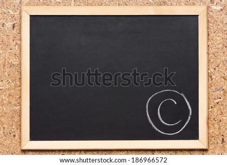 Letter C written on chalkboard, getting bad grades  - stock photo