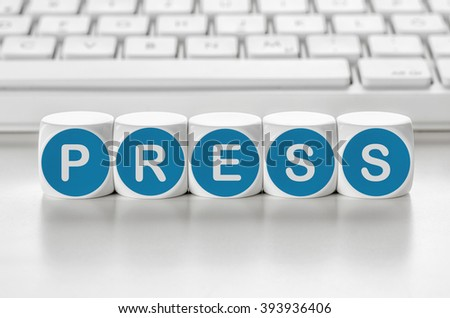 Letter dice in front of a keyboard - Press - stock photo