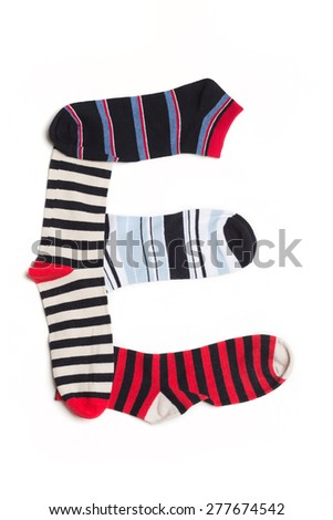 Letter  E made from colorfull socks isolated on white - stock photo