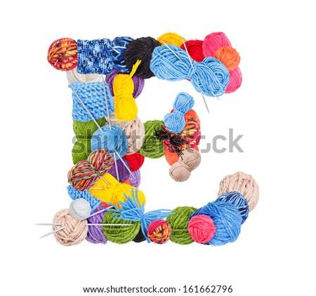Letter E made of knitting yarn isolated on white background - stock photo