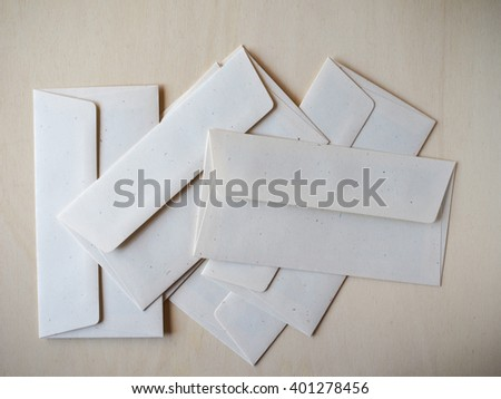 Letter envelopes for mail postage on wooden table - stock photo