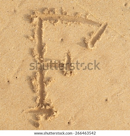 """letter """"F"""" in the sand - stock photo"""