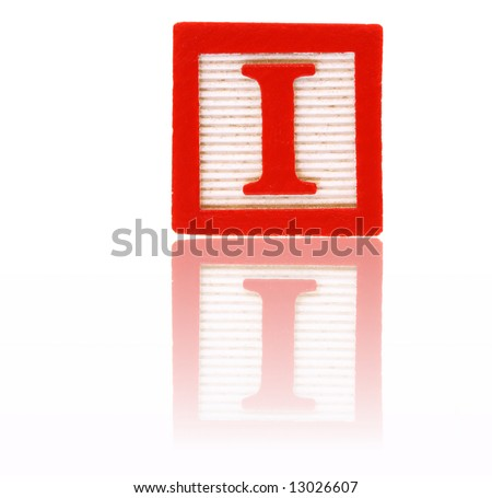 letter i in an alphabet wood block on a reflective surface - stock photo