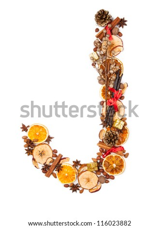 """Letter """"J"""" made of Christmas spices, dry orange and apple slices and small gifts. Isolated on white background - stock photo"""