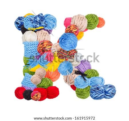 Letter K made of knitting yarn isolated on white background - stock photo