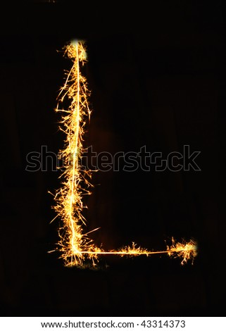 Letter L made of sparklers isolated on black - stock photo