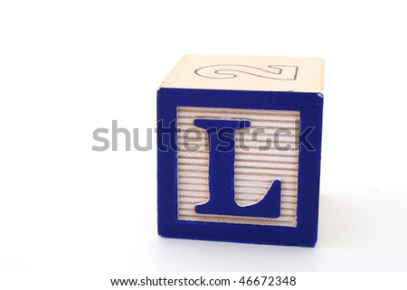 letter l of an alphabet block over a white surface - stock photo