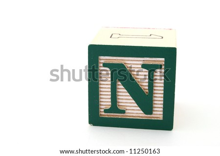 letter n in an alphabet wood block on a white surface - stock photo