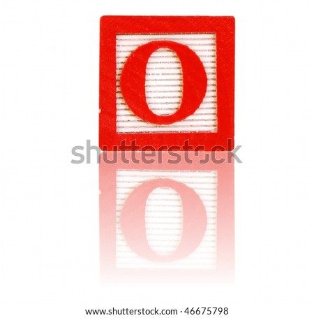 letter o in an alphabet wood block on a reflective surface - stock photo