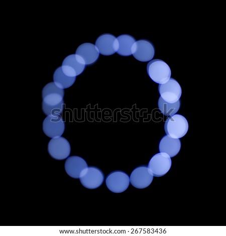 "letter of Christmas lights on a dark background, the letter O, ""blue bokeh"" - stock photo"