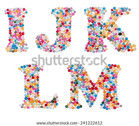 Letter set made of colorful sprinkles - capital letters I J K L M - stock photo