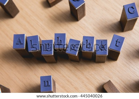 "Letter spelling the words ""Alphabet"" on wooden stamper - stock photo"