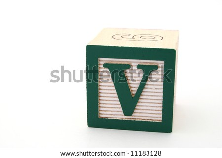 letter v in an alphabet wood block on a white surface - stock photo