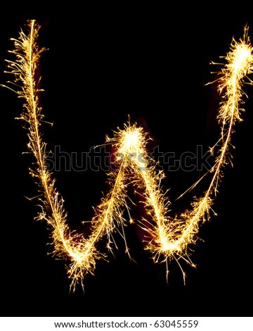 Letter W made of sparkler - stock photo