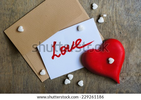 Letter with love note, red rose and sweers with hearts - stock photo