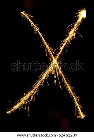 Letter X made of sparkler - stock photo