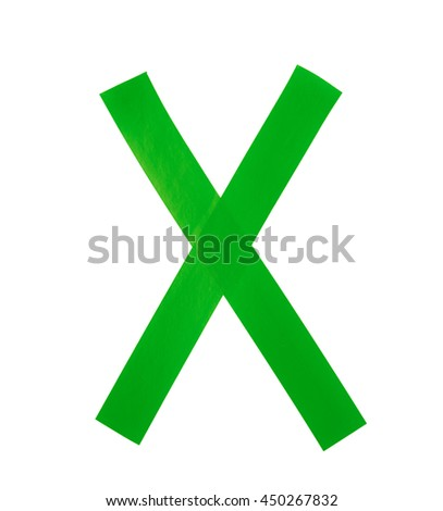 Letter X symbol made of insulating tape pieces, isolated over the white background
