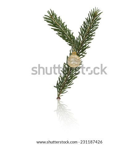 Letter Y made from fir branches, decorated with christmas balls and reflection. - stock photo