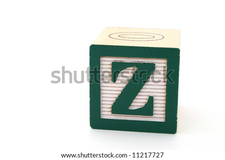 letter z in an alphabet wood block on a white surface - stock photo