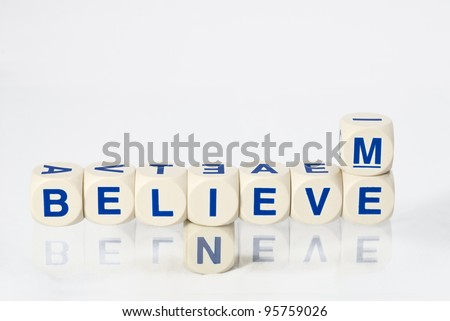 Lettered dice spell out the words believe in me
