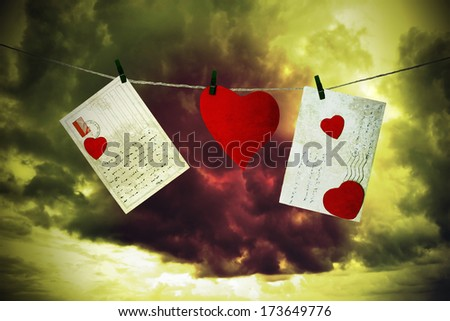 Letters and cardboard heart hanging by a thread - stock photo