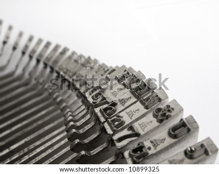 Letters and numbers of old typewriter keys.