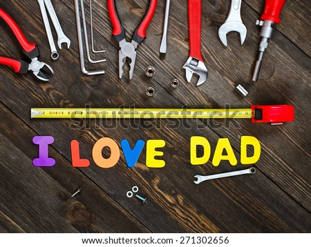 Letters and tools on a wooden background. - stock photo