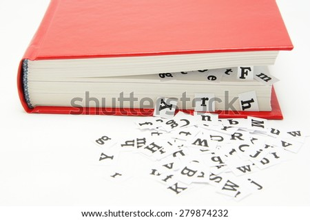Letters falling from the middle of the book.