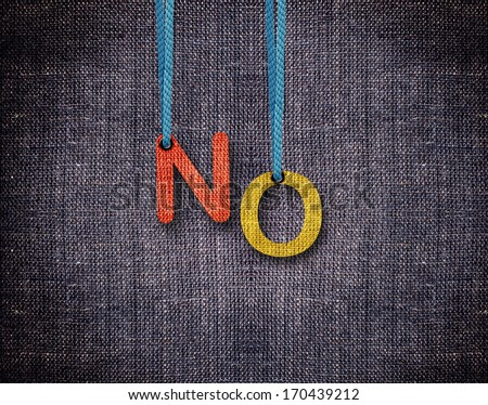 Letters hanging strings with blue sackcloth background. - stock photo