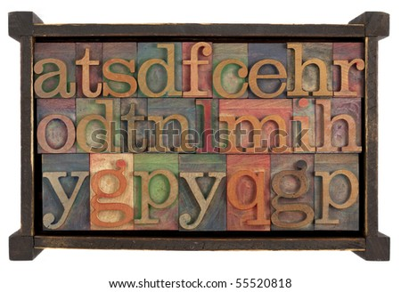 letters of alphabet (random selection) 0 vintage letterpress type blocks in rustic wooden box, isolated on white - stock photo