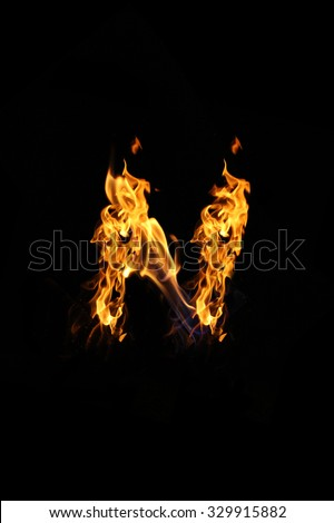 letters of fire n - stock photo