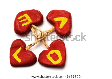 Letters of LOVE written in red hearts forming a circle - stock photo
