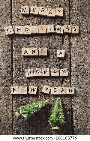 Letters spelling  Merry Christmas on wood - stock photo
