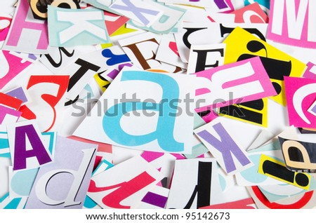 Letters which have been cut out from newspapers close up