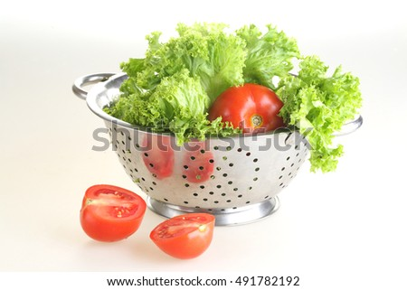 lettuce and fresh tomato the time recommended on white background