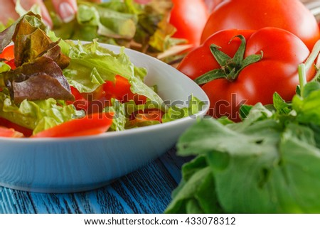 lettuce head, oil and seasoning over rustic wooden background - stock photo