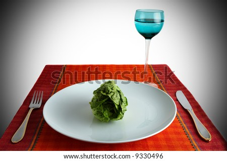 lettuce over a white dish - stock photo