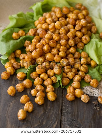 Lettuce with spicy roasted chickpeas - stock photo